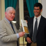 Talbert presents his latest book to Mellon Professor Dan Berman